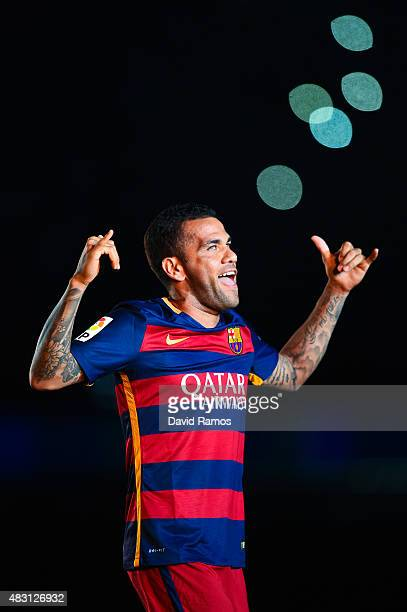 Dani Alves of FC Barcelona waves during the team official presentation ahead of the Joan Gamper trophy match at Camp Nou on August 5 2015 in...