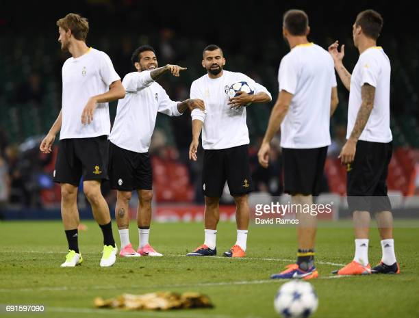 Dani Alves of Juventus and Tomas Rincon of Juventus speak to each other during a Juventus training session prior to the UEFA Champions League Final...
