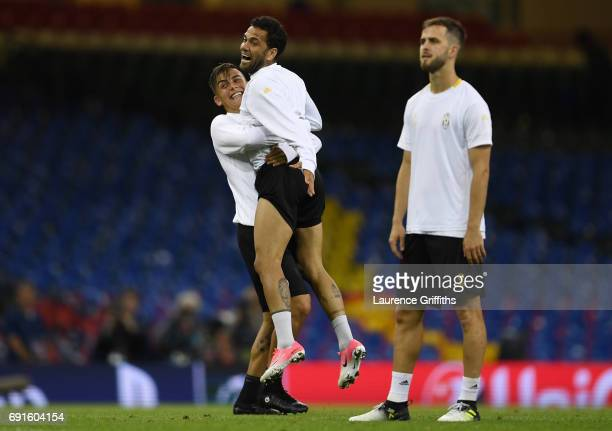 Dani Alves of Juventus celerbates with Paulo Dybala of Juventus during a Juventus training session prior to the UEFA Champions League Final between...