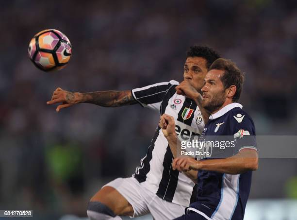 Dani Alves of Juventus FC competes for the ball with Senad Lulic of SS Lazio during the TIM Cup Final match between SS Lazio and Juventus FC at...