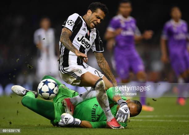 Dani Alves of Juventus is challanged by Keylor Navas of Real Madrid during the UEFA Champions League Final between Juventus and Real Madrid at...