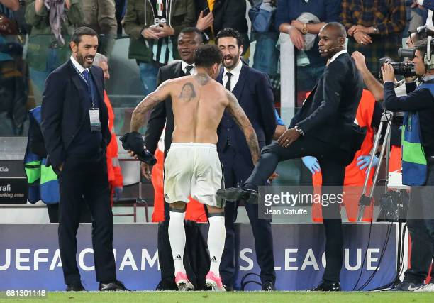 Dani Alves of Juventus jokes with former teammate in Barcelona Eric Abidal now working for beIN Sports while Robert Pires and Marcel Desailly look on...