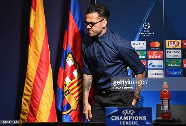 Dani Alves of Juventus takes his seat to speak to the media during the Juventus press conference at the Camp Nou on April 18 2017 in Barcelona Spain