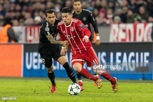 Dani Alves of Paris SaintGermain and James Rodriguez of Bayern Muenchen battle for the ball during the UEFA Champions League group B match between...