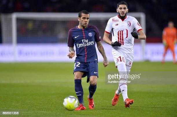 Dani Alves of Paris SaintGermain passes the ball during the Ligue 1 match between Paris Saint Germain and Lille OSC at Parc des Princes on December 9...