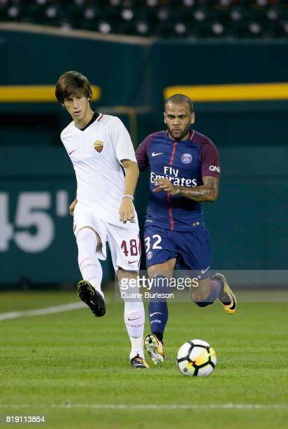 Dani Alves of Paris SaintGermain pursues Mirko Antonucci of AS Roma down the pitch during the second half at Comerica Park on July 19 2017 in Detroit...