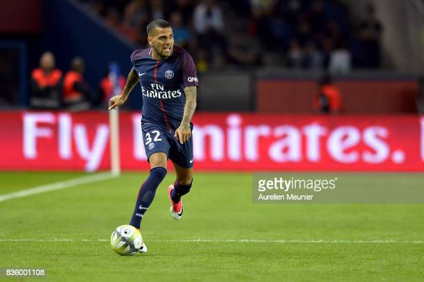 Dani Alves of Paris SaintGermain runs with the ball during the Ligue 1 match between Paris SaintGermain and Toulouse at Parc des Princes on August 20...