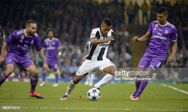 Dani Carvajal and Casemiro of Real Madrid watch Alex Sandro of Juventus during the UEFA Champions League Final between Juventus and Real Madrid at...