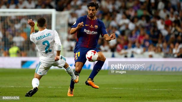 Dani Carvajal aof Real Madrid and Andre Gomes of Barcelona battle for the ball during the Supercopa de Espana Supercopa Final 2nd Leg match between...