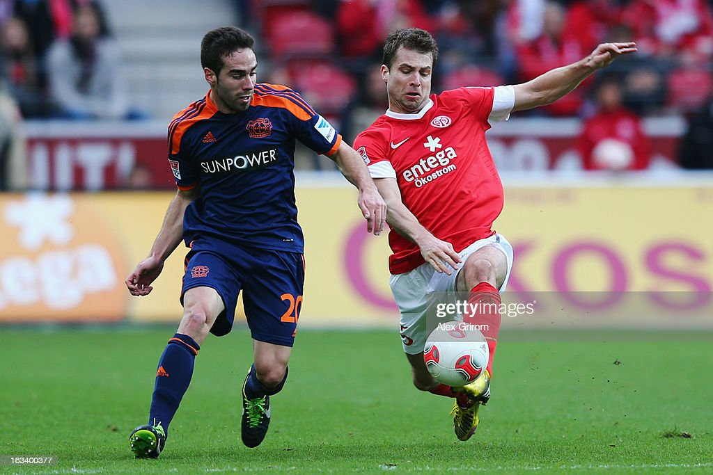Dani Carvajal (L) of Leverkusen is challenged by <a gi-track='captionPersonalityLinkClicked' href=/galleries/search?phrase=Andreas+Ivanschitz&family=editorial&specificpeople=2140350 ng-click='$event.stopPropagation()'>Andreas Ivanschitz</a> of Mainz during the Bundesliga match between 1. FSV Mainz 05 and Bayer 04 Leverkusen at Coface Arena on March 9, 2013 in Mainz, Germany.