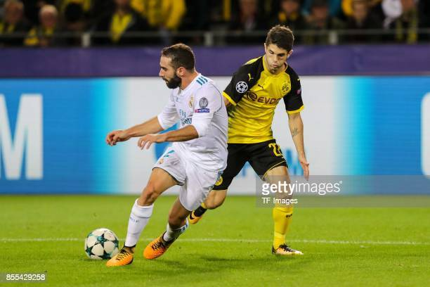 Dani Carvajal of Real Madrid and Christian Pulisic of Dortmund battle for the ball during the UEFA Champions League group H match between Borussia...