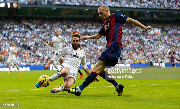 Dani Carvajal of Real Madrid and Jérémy Mathieu of Barcelono fc compete for the ball during the La Liga match between Real Madrid CF and FC Barcelona...