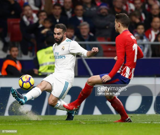 Dani Carvajal of Real Madrid and Lucas Fernandez of Atletico de Madrid compete for the ball during the La Liga match between Atletico Madrid and Real...