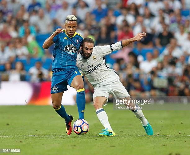 Dani Carvajal of Real Madrid and Theo Bongonda of Celta compete for tha ball during the La Liga match between Real Madrid CF and RC Celta de Vigo at...