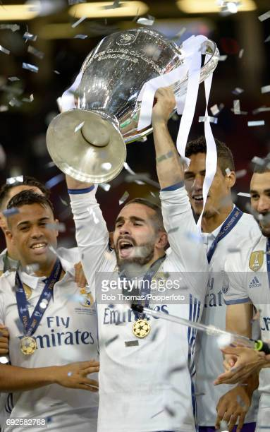 Dani Carvajal of Real Madrid celebrates with the trophy after the UEFA Champions League Final between Juventus and Real Madrid at National Stadium of...