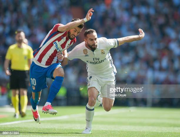 Dani Carvajal of Real Madrid fends off Yannick Carrasco of Club Atletico de Madrid during the La Liga match between Real Madrid CF and Club Atletico...