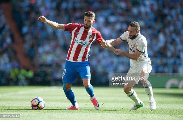Dani Carvajal of Real Madrid fholds onto Yannick Carrasco of Club Atletico de Madrid during the La Liga match between Real Madrid CF and Club...