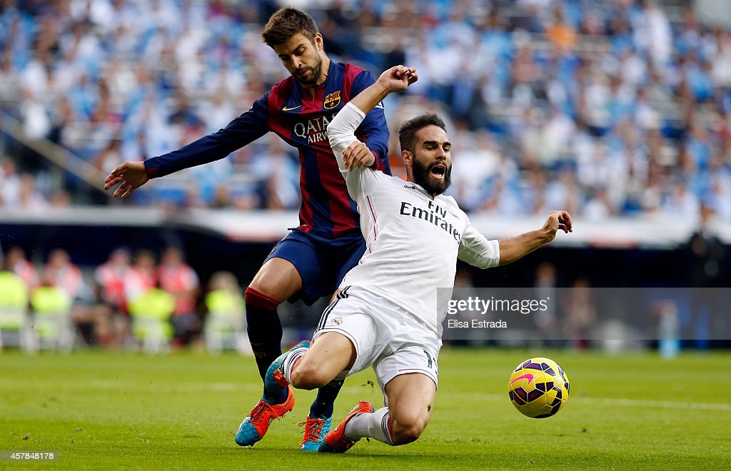 Dani Carvajal (R) of Real Madrid fights for the ball with <a gi-track='captionPersonalityLinkClicked' href=/galleries/search?phrase=Gerard+Pique&family=editorial&specificpeople=227191 ng-click='$event.stopPropagation()'>Gerard Pique</a> of Barcelona during the La Liga match between Real Madrid CF and FC Barcelona at Estadio Santiago Bernabeu on October 25, 2014 in Madrid, Spain.