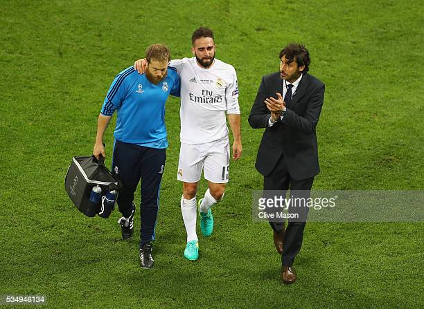 Dani Carvajal of Real Madrid is is lead of the pitch as he substituted after getting injured during the UEFA Champions League Final match between...