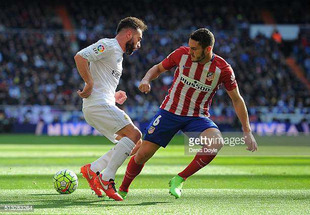 Dani Carvajal of Real Madrid is tackled by Koke Resurreccion of Club Atletico de Madrid during the La Liga match between Real Madrid CF and Club...