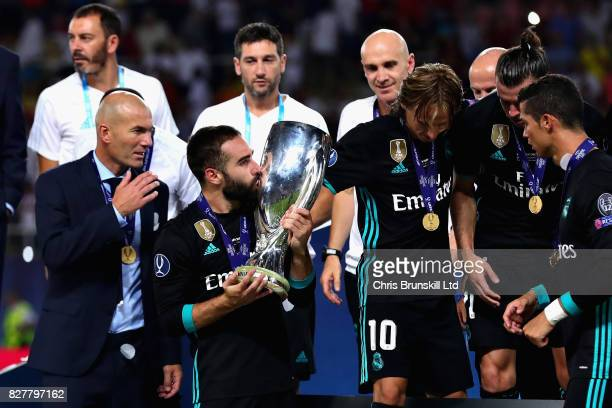 Dani Carvajal of Real Madrid kisses the trophy as his team celebrate the win after the UEFA Super Cup match between Real Madrid and Manchester United...