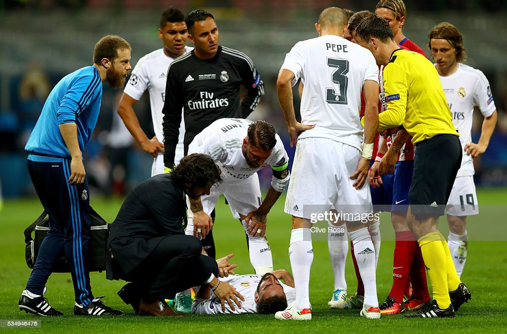 Dani Carvajal of Real Madrid lies on the pitch injured during the UEFA Champions League Final match between Real Madrid and Club Atletico de Madrid at Stadio Giuseppe Meazza on May 28, 2016 in Milan, Italy.