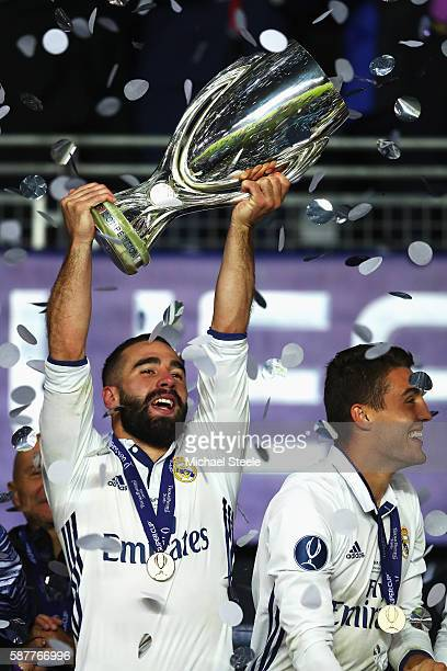 Dani Carvajal of Real Madrid lifts the trophy after his team's victory during the UEFA Super Cup match between Real Madrid and Sevilla at Lerkendal...