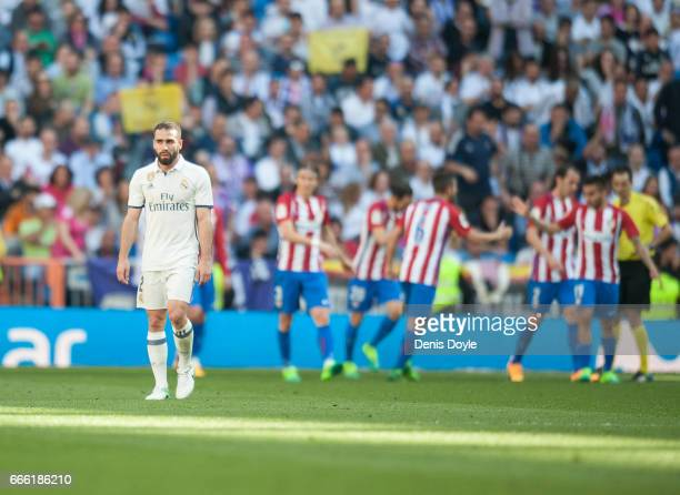 Dani Carvajal of Real Madrid looks on after Club Atletico de Madrid scored the equalizing goal during the La Liga match between Real Madrid CF and...