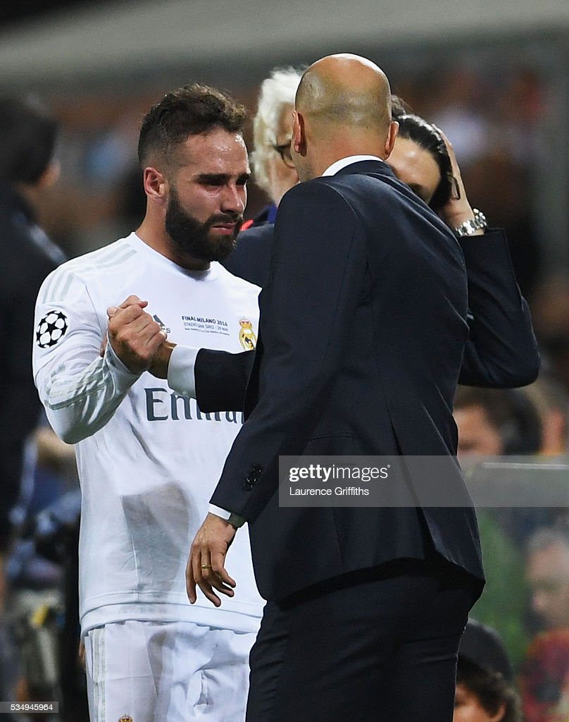 Dani Carvajal of Real Madrid shakes the hand to head coach <a gi-track='captionPersonalityLinkClicked' href=/galleries/search?phrase=Zinedine+Zidane&family=editorial&specificpeople=172012 ng-click='$event.stopPropagation()'>Zinedine Zidane</a> after being substituted during the UEFA Champions League Final match between Real Madrid and Club Atletico de Madrid at Stadio Giuseppe Meazza on May 28, 2016 in Milan, Italy.