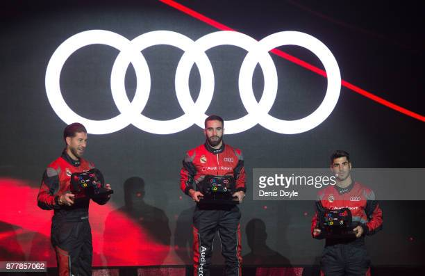 Dani Carvajal Sergio Ramos and Marco Asensio of Real Madrid pose on the podium after coming 1st 2nd and 3rd respectively during the simulated Formula...