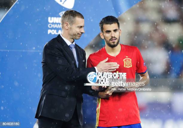 Dani Ceballos is presented with the trophy for the top scorer during the UEFA U21 Final match between Germany and Spain at Krakow Stadium on June 30...