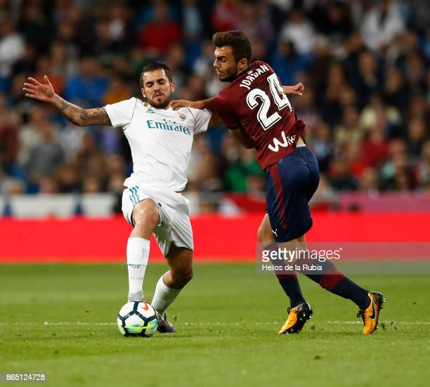 Dani Ceballos of Real Madrid and Joan Jordan of Eibar cf compete for the ball during the La Liga match between Real Madrid and Eibar at Estadio...