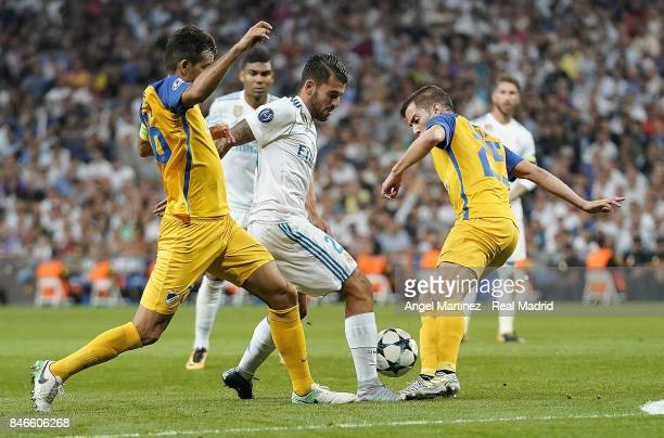 Dani Ceballos of Real Madrid competes for the ball with Agustin Farias and Nuno Morais of APOEL Nikosia during the UEFA Champions League group H...