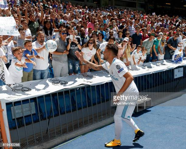 Dani Ceballos of Real Madrid gives a ball to a young fan during his official presentation at Estadio Santiago Bernabeu on July 20 2017 in Madrid Spain