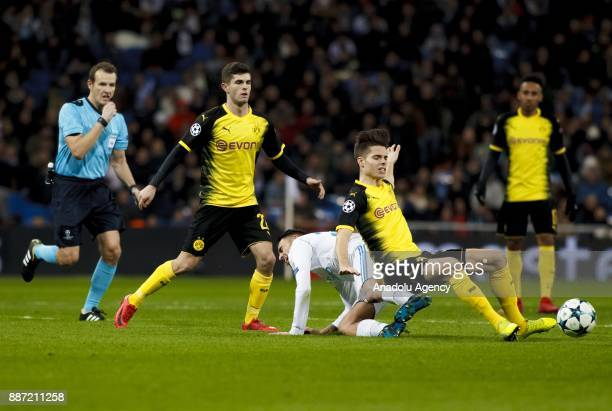 Dani Ceballos of Real Madrid in action against Julian Weigl of Borussia Dortmund during the UEFA Champions League group H match between Real Madrid...