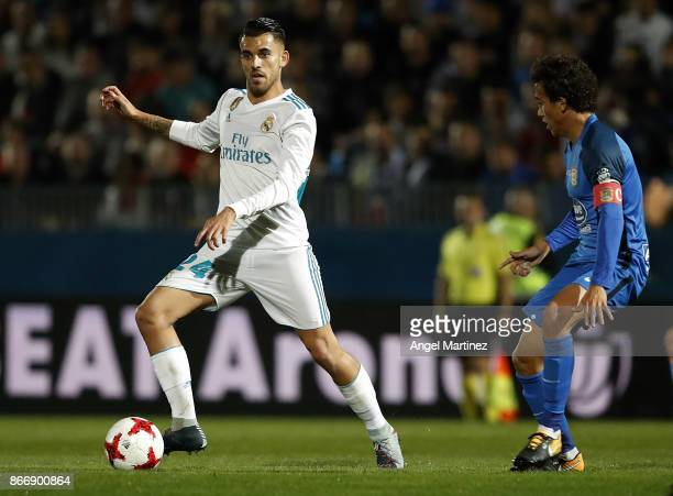 Dani Ceballos of Real Madrid is challenged by Luis Milla of Fuenlabrada during the Copa del Rey round of 32 first leg match between Fuenlabrada and...