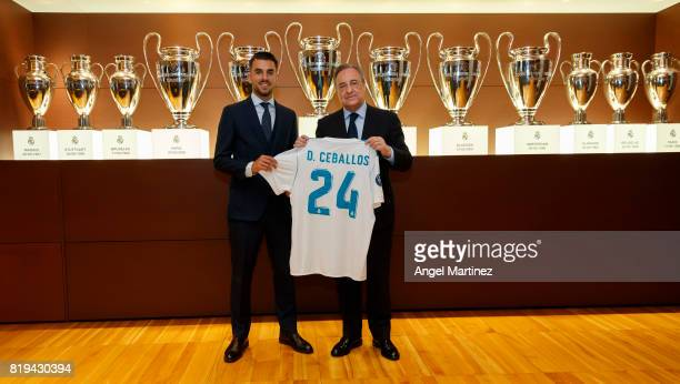 Dani Ceballos of Real Madrid poses with President Florentino Perez during his official presentation at Estadio Santiago Bernabeu on July 20 2017 in...