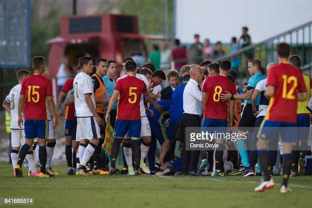 Dani Ceballos of Spain lies injured while Italian and Spanish players argue during the Italy v Spain Under21 Friendly match at Estadio Municipal...
