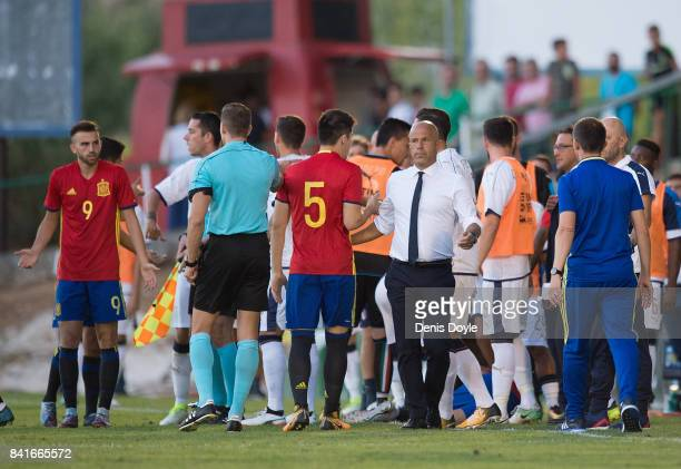 Dani Ceballos of Spain lies injured while Italian manager Luigi Di Biagio talks to Spanish playerJorge Mere during the Italy v Spain Under21 Friendly...