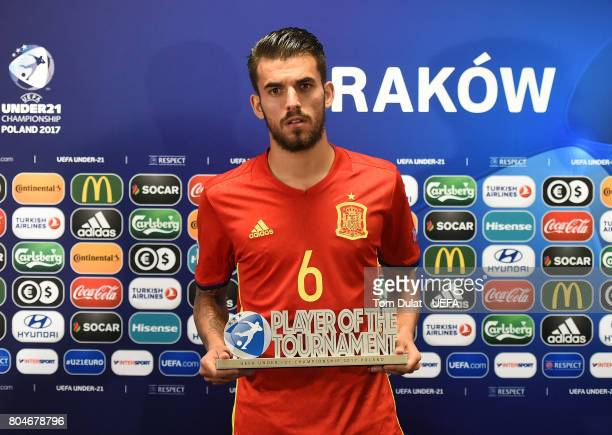 Dani Ceballos of Spain poses for photos with Player Of The Tournament award after the UEFA European Under21 Championship Final match between Germany...