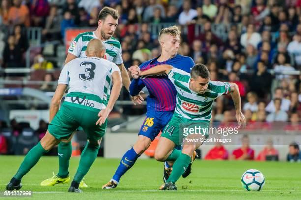 Dani Garcia Carrillo of SD Eibar fights for the ball with Gerard Deulofeu Lazaro of FC Barcelona during the La Liga 201718 match between FC Barcelona...