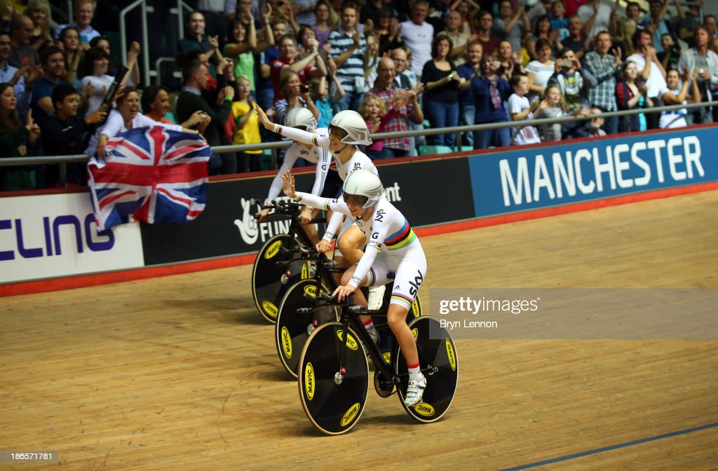 Dani King of Great Britain celebrates with team-mate Laura Trott after setting a new world record time of 4:19.604 during the Women's Team Pursuit Finals on day one of the UCI Track Cycling World Cup at Manchester Velodrome on November 1, 2013 in Manchester, England.