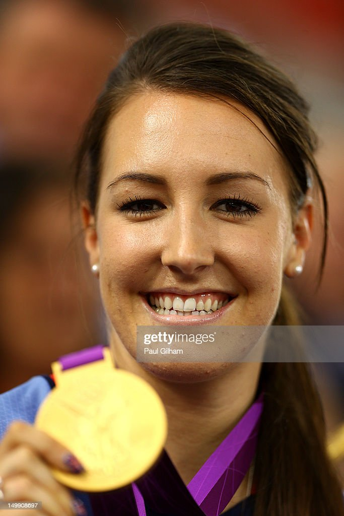 <a gi-track='captionPersonalityLinkClicked' href=/galleries/search?phrase=Dani+King+-+Cyclist&family=editorial&specificpeople=7505449 ng-click='$event.stopPropagation()'>Dani King</a> of Great Britain poses with her medal as she visits to support team-mate Laura Trott of Great Britain as she competes in the Women's Omnium Track Cycling on Day 10 of the London 2012 Olympic Games at Velodrome on August 6, 2012 in London, England.