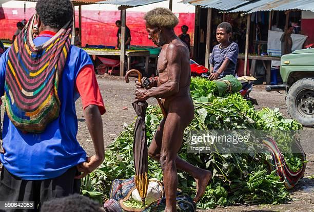 Dani man wearing a koteka at the market Wamena Papua Indonesia