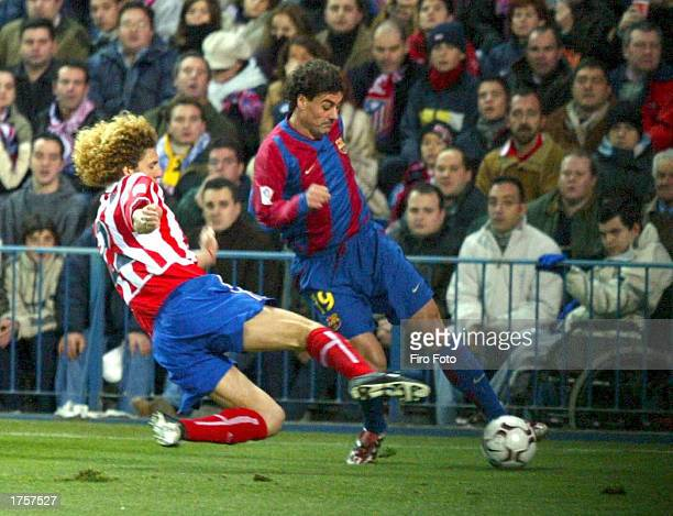 Dani of Barcelona and Coloccini of Athletico Madrid in action during the Athletico Madrid v Barcelona match of liga 1 division which Athletico Madrid...