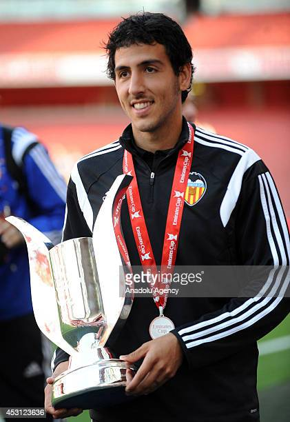 Dani Parejo of Valencia with the trophy after the Emirates Cup 2014 match between Arsenal and AS Monaco at Emirates Stadium in London England on...