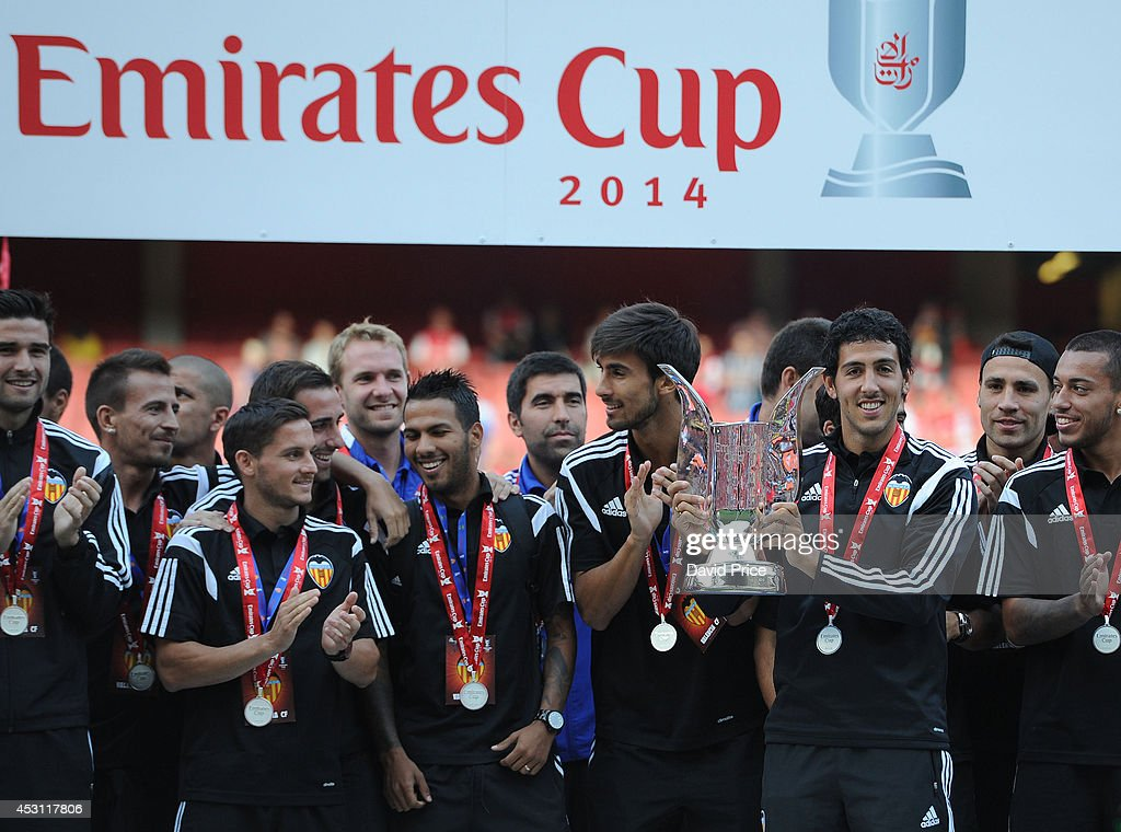 Dani Parejo the captian of Valencia lifts the Emirates Cup Trophy after the Emirates Cup match between Arsenal and AS Monaco at Emirates Stadium on August 3, 2014 in London, England.