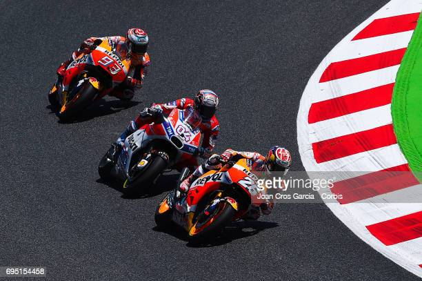 Dani Pedrosa and Marc Marquez of Repsol Honda Team and Andrea Dovizioso of Ducati Team riding his bikes during the Moto GP race Moto GP of Catalunya...