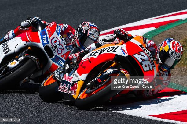 Dani Pedrosa of Repsol Honda Team and Andrea Dovizioso of Ducati Team in action with his bikes during the Moto GP race Moto GP of Catalunya at...