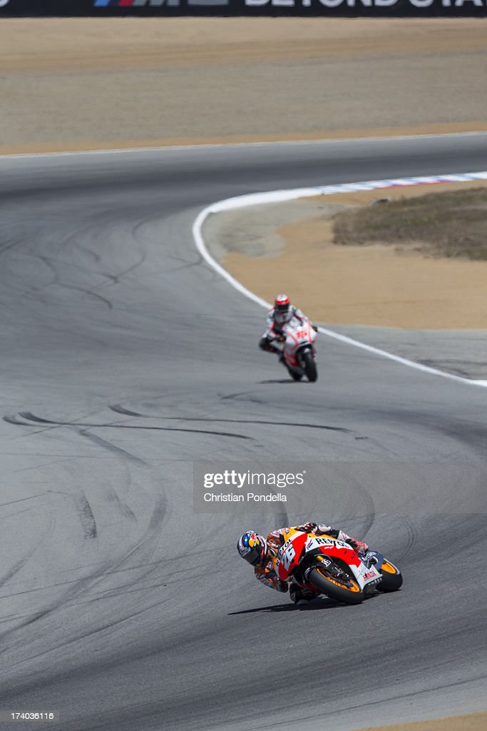 Dani Pedrosa of Spain and Repsol Honda Team accelerates out of the corner at the MotoGP race of Red Bull U.S. Grand Prix at Mazda Raceway Laguna Seca on July 19, 2013 in Monterey, California.